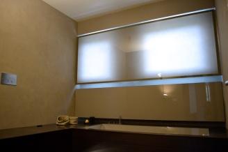 sala da bagno in terra cruda tonalizzata per Archiplan